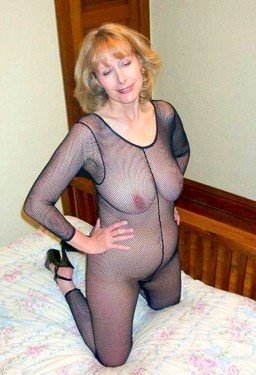 Busty blonde MILF in fetish fishnet..