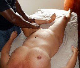 Black masseuse caresses an old whore..