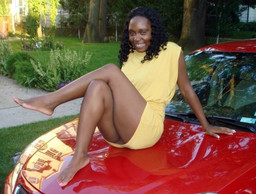 Leggy black girls posing in the car