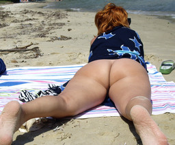 Wife naked on the beach enjoying the..