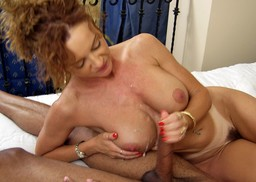 Messy cumshot on huge boobs, she..