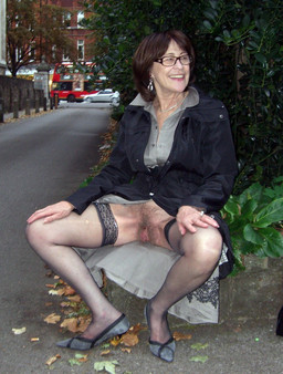 Dissolute granny in stockings exposing..