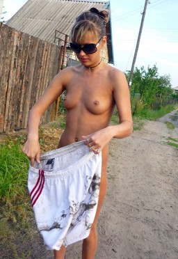 Young teenager naturist posing at..